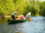 The crew in canoes on the beautiful Brule